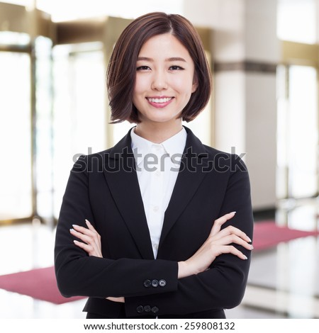 Yong pretty Asian business woman isolated on business background.