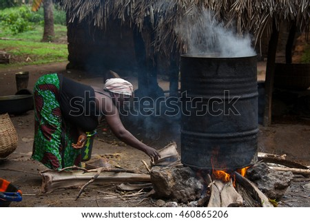 Yongoro, Sierra Leone - June 03, 2013: West Africa, the village of Yongoro in front of Freetown, woman while working the palm oil