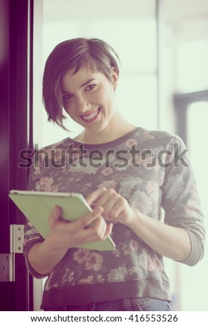 yonug businesswoman in casual hipster clothes working on tablet computer at modern startup business office interior - stock photo