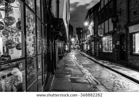 YORK, UK - August 05: The Shambles is a former butchers' street in York with some buildings dating back from the fourteenth century. August 05, 2015 in York. - stock photo