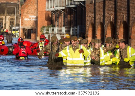 YORK, UK - DECEMBER 27th 2015: Flood rescue by the British Army and the Mountain Rescue at Queens Staith Road near the Ouse Bridge in York City Centre after heavy rain, on 27th December  2015. - stock photo
