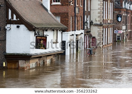 YORK, UK - DECEMBER 28th 2015: Flooded streets at King's Staith in York City Centre after heavy rain, on 28th December  2015. - stock photo