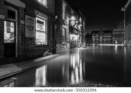 YORK, UK - DECEMBER 6th 2015: Floodwater at the Ouse Bridge in York City Centre after heavy rain, on 6th December  2015. - stock photo