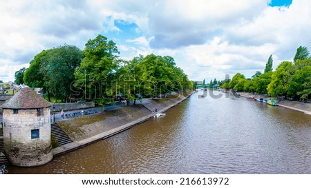 York, United Kingdom - August 9, 2014: View over River Ouse and bridge in the city of York, UK.York is a historic walled city at the confluence of the Rivers Ouse and Foss in North Yorkshire, England. - stock photo
