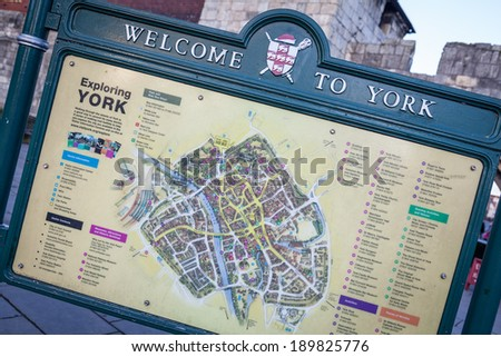 YORK, UNITED KINGDOM - DECEMBER 22, 2013: Welcome to York sign with tourist city map highlighting main city's attractions. York is a city in North Yorkshire county in England, UK - stock photo