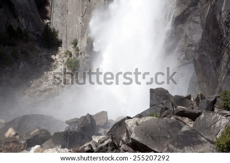 Yosemite National Park, CA/ Yosemite falls/ Only after a heavy rain will Yosemite falls drop to all three tiers and send rushing water down the Merced River on the Valley Floor.  - stock photo