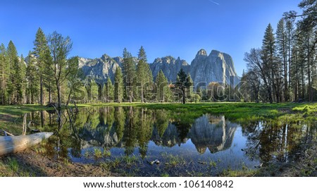 Yosemite Valley is a glacial valley in Yosemite National Park in the western Sierra Nevada mountains of California, carved out by the Merced River. - stock photo