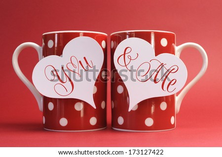 You and Me, love message greeting on heart gift tags on red polka dot coffee mugs for Valentines Day, Mothers Day, birthday, wedding or loving occasion. - stock photo