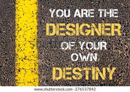 You are the designer of your own destiny motivational quote. Yellow paint line on the road against asphalt background. Concept image - stock photo