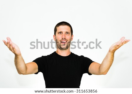 You are welcome! Close-up of young caucasian man smiling with arms up - isolated on white background - stock photo