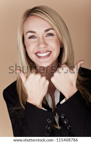 You blond businesswoman holding her thumbs up. Thumbs up. - stock photo