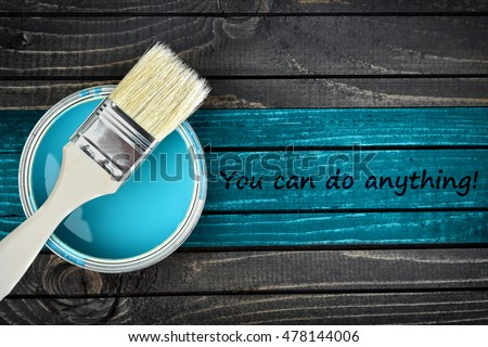 You can do anything message and paintbrush on wooden table