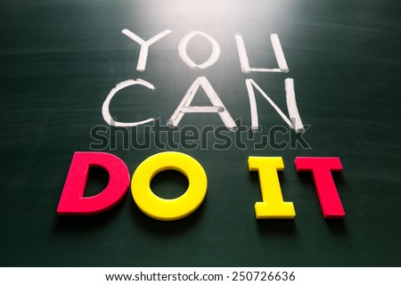 You can do it concept, colorful words on blackboard - stock photo
