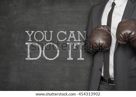 You can do it on blackboard with businessman on side - stock photo