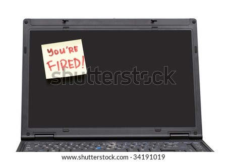 You're Fired post-it note on notebook screen - stock photo