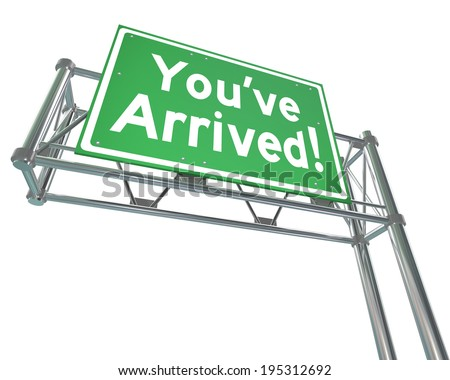 You've Arrived words on a green freeway road sign arriving your destination - stock photo