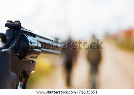 you with a gun aiming to people - stock photo