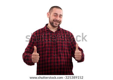 Youn man showing thumbs up. Success - stock photo
