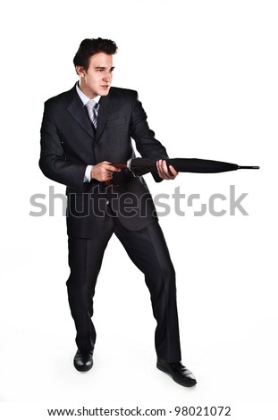Young, a respected and successful businessman in a dark business suit with an umbrella