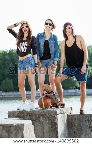 Young active people. Group of two woman and one man with sports equipment. Outdoors, lifestyle - stock photo