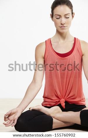 Young active woman doing yoga - stock photo