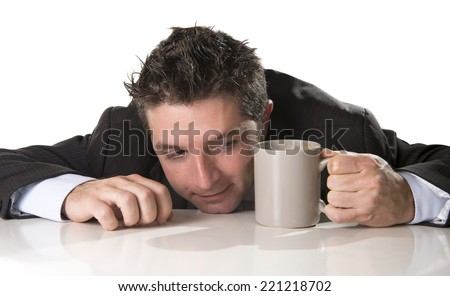 young addict business man in suit and tie holding cup of coffee anxious and crazy in caffeine addiction and need to keep awaken isolated on white background