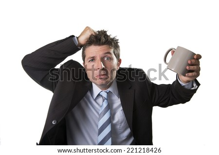 young addict business man in suit and tie holding empty cup of coffee anxious , desperate and crazy in caffeine addiction and need to keep awake isolated on white background - stock photo