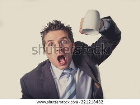 young addict business man in suit and tie holding empty cup of coffee anxious , desperate and crazy in caffeine addiction and need to keep awake isolated on clear background - stock photo