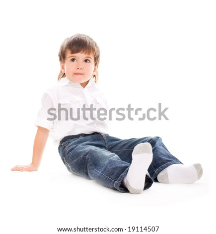 Young adorable boy sitting on isolated white