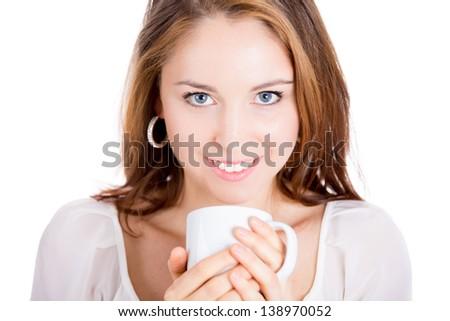 Young adorable woman drinking out of white cup