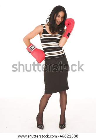 Young adult African-Indian businesswoman in red boxing gloves as a metaphor for office politics on a white background. Not Isolated