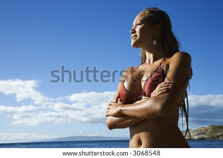 Young adult Asian Filipino in bikini on beach in Maui Hawaii.