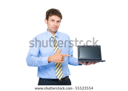 young adult, businessman point to small 10 inch laptop, netbook screen, recommending or suggesting, studio shoot isolated on white background - stock photo