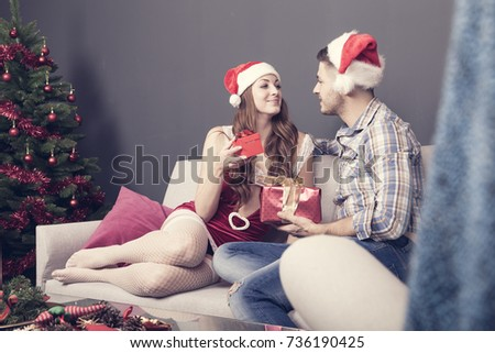Young Adult Couple Celebrate Christmas Home Stock Photo (Royalty ...