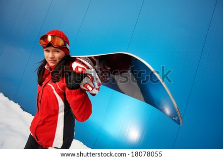 young adult female snowboarder. - stock photo