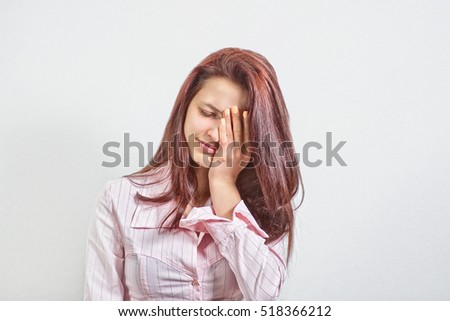 Young Adult Female Wearing Blouse Covers Her Face by Hand, Crying, Gesturing She Has Made a Big Mistake