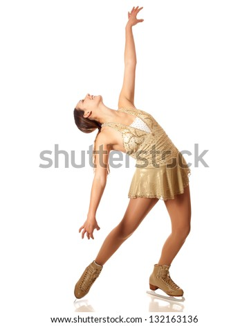 Young adult figure skater. Studio shot over white. - stock photo