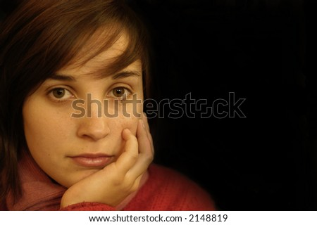 young adult girl with sad eyes portrait - stock photo