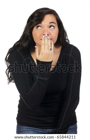 Young adult lady holds her hand over her mouth in embarrassment.