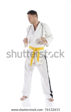 Young adult man doing martial arts, isolated against a white background - stock photo