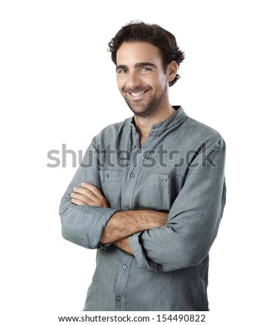 Young adult man looking at camera smiling isolated - stock photo