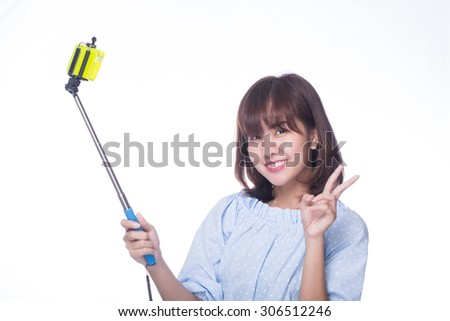 Young adult post for selfie with white background.