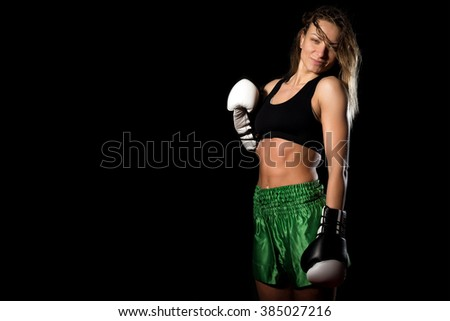 Young adult sexy female takes portrait photo during kickboxing exercise