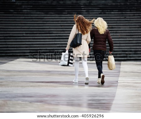 Young adult shopping women on Sergels Torg, very recogniszble Stockholm Square
