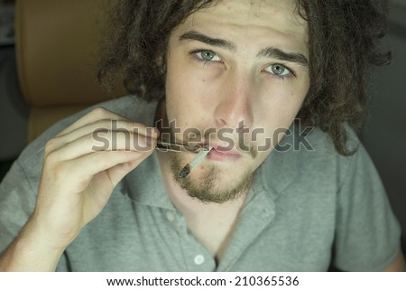 Young adult smoking marijuana