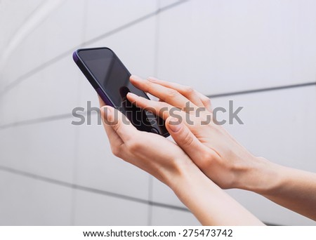 Young adult using mobile smart phone - stock photo