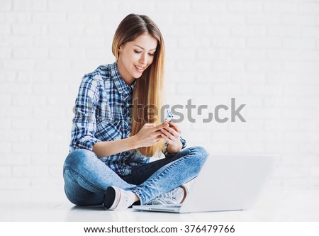 Young adult using smart phone - stock photo