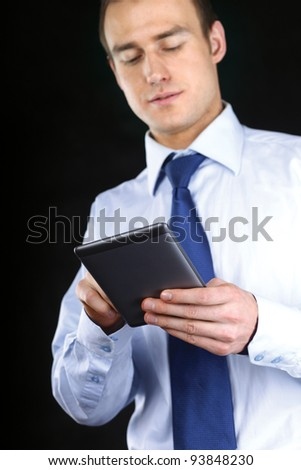 Young adult working on a digital tablet - stock photo