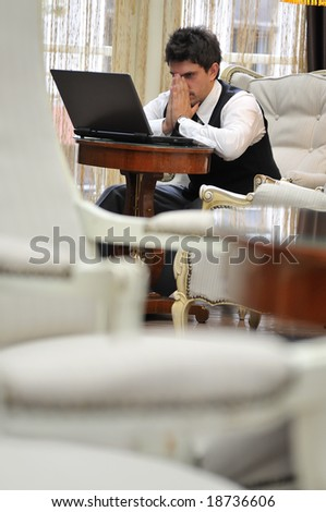 young adult working on laptop - stock photo