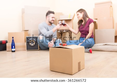 Young adults celebrating their moving - stock photo